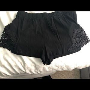 Black shorts with flowers cutouts